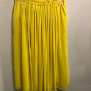 Bright yellow mid length skirt with pockets